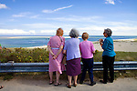 Four senior women viewing the ocean and beach. Cape Cod.