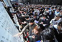March 10, 2011, Tokyo, Japan - Applicants check their names on the list as Tokyo University announces the results of the second phase of its entrance examinations on the Hongo campus in Tokyo on Thursday, March 10, 2011. A total of 3009 applicants passed the exams to be enrolled by the nationÅfs most prestigious institution. (Photo by Natsuki Sakai/AFLO) [3615] -mis-