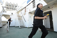 Haifa, Israel:.Trainees, Tamara Raich at right, participate in a drill, during a course teaching to fight maritime terror and piracy, on a boat in Haifa Port..June 11, 2009 (Photo by Ahikam Seri).