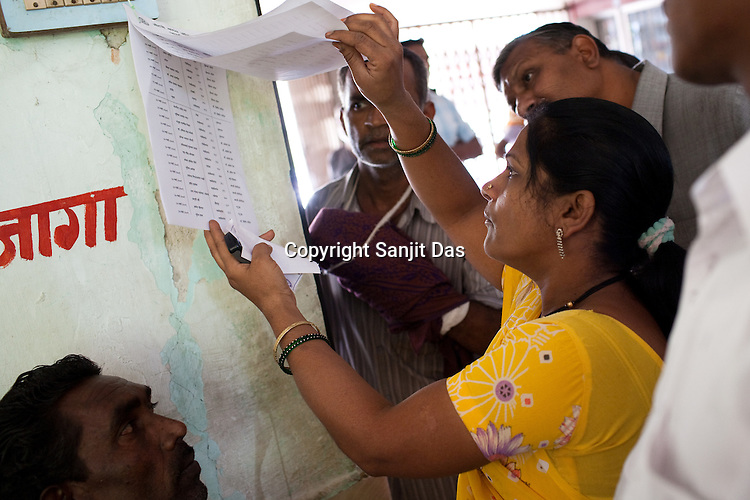 Patients check their names on the list as they wait to see the visiting doctors in the local hospital in Chalisgaon, Maharashtra, India. Rotary Club organises a free medical camp for the poor and needy. India's leading Micro and plastic surgeons visit the medical camp and provide free medical service.