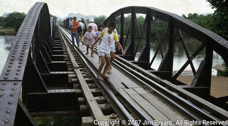 The Bridge on the River Kwai, known to many P.O.W.'s as the bridge of sorrow, attracts thousands of tourists yearly. in Kanchanaburi, Thailand. Over 16,000 allied P.O.W.s died of starvation, maltreatment and disease while building the bridge on the River Kwai and a 250- mile railway from Thailand into Burma. (Jim Bryant Photo).....