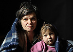 """THIS PHOTO IS AVAILABLE AS A PRINT OR FOR PERSONAL USE. CLICK ON """"ADD TO CART"""" TO SEE PRICING OPTIONS.   Arbanac Sofija and her 3-year old daughter Caka huddle under a blanket - provided by Church World Service - inside their meager home in an illegal Roma settlement in Belgrade, Serbia, in February 2012. The poor family has been told it will be evicted by city officials in March 2012 to make way for new high-rise office buildings. Roma in Belgrade, often living in miserable conditions, have faced increasing evictions in order to make way for high-rise developments."""