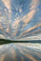 Sunrise and clouds over Naknek lake, Aleutian mountain range, Katmai National Park, Alaska.