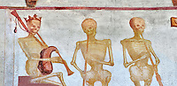 The Church of San Vigilio in Pinzolo and its fresco paintings &ldquo;Dance of Death&rdquo; painted by Simone Baschenis of Averaria in1539, Pinzolo, Trentino, Italy.<br /> <br /> The mural continues for another 21 meters with a long procession with 40 figures. The Mural opens on its left with a skeleton on the throne, bearing a sceptre and the crown and playing a bagpipe. These skeletons are playing the music which is the backdrop to &ldquo;Dance of Death&rdquo; ( Danza macabra ) and suggests that they are playing with our fate on earth.