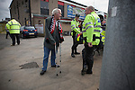 An elderly home team fan talking to police officers inside Seaview Park, Belfast before Northern Irish club Crusaders take on Fulham in a UEFA Europa League 2nd qualifying round, fist leg match. The visitors from England won by 3 goals to 1 before a crowd of 3011.