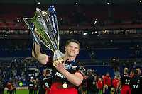 Owen Farrell of Saracens lifts the European Rugby Champions Cup trophy. European Rugby Champions Cup Final, between Saracens and Racing 92 on May 14, 2016 at the Grand Stade de Lyon in Lyon, France. Photo by: Patrick Khachfe / Onside Images