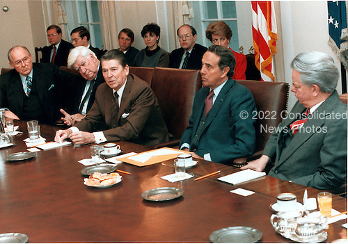 """United States President Ronald Reagan meets with a bi-partisan group of Congressional leaders in the Cabinet Room of the White House in Washington, D.C. on Friday, January 4, 1985.  From left are: United States House Minority Leader Robert Michel (Republican of Illinois); Speaker of the United States House of Representatives Thomas P. """"Tip"""" O'Neill (Democrat of Massachusetts); The President; United States Senate Majority Leader Robert Dole (Republican of Kansas); and United States Senate Minority Leader Robert Byrd (Democrat of West Virginia)..Mandatory Credit: Bill Fitz-Patrick - White House via CNP"""