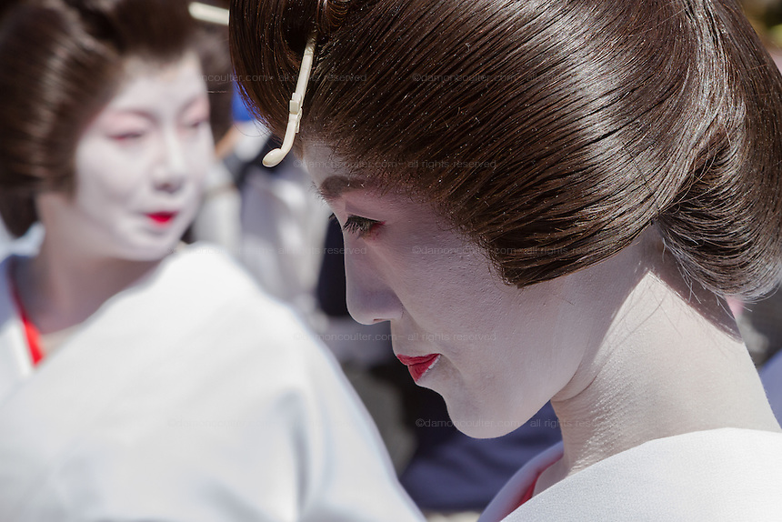 Geisha take part in the Daigyoretsu or Grand Parade on the first day of the Sanja matsuri in Asakusa, Tokyo, Japan. Friday May 13th 2016. The Sanja matsuri is one of the biggest festivals in Japan. Taking place over the 3 days of the second weekend of May (May 13th to 15th) it features many mikoshi, or portable shrines, that are carried around by local groups to bring blessings and prosperity to their neighbourhoods