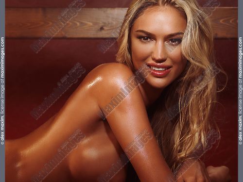 Portrait of a smiling sexy woman with blond hair in sauna