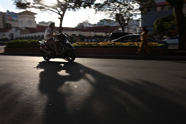 A motorbike speeds along in the late afternoon near the Ben Thanh Market in Ho Chi Minh City, Vietnam. Sept. 10, 2011.