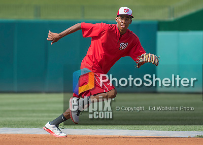 22 July 2016: Son of Washington Nationals Manager Dusty Baker, Darren Baker fields infield grounders during batting practice prior to a game against the San Diego Padres at Nationals Park in Washington, DC. The Padres defeated the Nationals 5-3 to take the first game of their 3-game, weekend series. Mandatory Credit: Ed Wolfstein Photo *** RAW (NEF) Image File Available ***