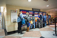 Travelers buy tickets at the NJ Transit station in Penn Station in New York on Tuesday, March 8, 2016. New Jersey Transit rail workers planning on striking on Sunday, March 13 at 12:01AM if a deal with NJT is not hammered out. On Monday 160,000 riders  who use the rail system on a weekday will have to contend with contingency plans that can only accommodate 40 percent of them.  (© Richard B. Levine)