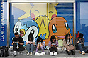 May 9, 2010 - Tokyo, Japan - Young and adults Japanese people play Nintendo's portable video game 'DS' in front of the official Pokemon store in Tokyo on May 9, 2010. Nintendo recently announced that the DS handheld device had become the best selling gaming handheld of all time, with a total of 129 million units sold. The DS 'family' have surpassed the &quot;Game Boy&quot; series which hit 118 million over two decades.