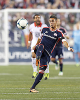 New England Revolution midfielder Diego Fagundez (14) collects a pass.  In a Major League Soccer (MLS) match, the New England Revolution (blue) defeated D.C. United (white), 2-1, at Gillette Stadium on September 21, 2013.