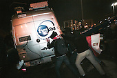 Warsaw 11.11.2011 Poland<br /> Hooligans try to destroy TVN-24 tv station car during Polish Independence Day Demonstration in Warsaw. Violent clashes erupted in Warsaw on Friday as right-wing extremists, football hooligans and anarchists attacked police with cobblestones and glass bottles during marches commemorating the country's Independence Day.<br /> At least 21 people were taken to hospitals with injuries following the clashes, which were some of the most violent Poland has seen in years. Several police officers were also injured.<br /> Photo: Adam Lach / Napo Images for Newsweek Polska<br /> <br /> Huliganie staraja sie zniszczyc samochod TVN-24  podczas demonstracji i walk z policja skrajnej prawicy na ulicach Warszawy z okazji swieta niepodleglosci.<br /> Fot: Adam Lach / Napo Images dla Newsweek Polska