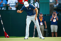 Dustin Johnson celebrates his birdie on the 18th green and his first major win during the 2016 U.S. Open in Oakmont, Pennsylvania on Sunday June 19, 2016. (Photo by Jared Wickerham / DKPS)