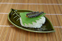 "Sakura moth caterpillar sushi. Tokyo resident Shoichi Uchiyama is the author of ""Fun Insect Cooking"". His blog on the topic gets 400 hits a day. He believes insects could one day be the solution to food shortages, and that rearing bugs at home could dispel food safety worries."