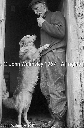 "Farmer with his working dog, Dunquin (in Gaelic, Dún Chaoin, meaning ""Caon's stronghold""), on the tip of the Dingle Peninsula, County Kerry, Ireland.  1971."
