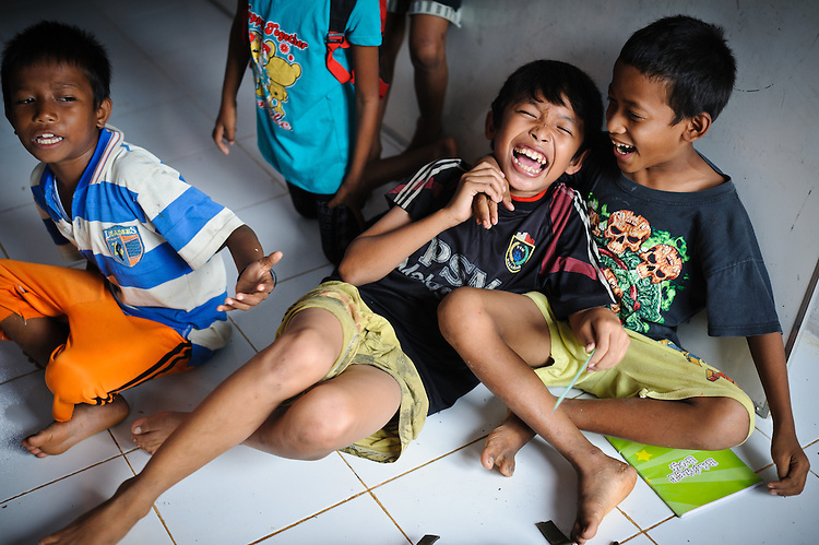 Ashuar, 12, playing at the school supported by the Sacred Childhoods Foundation, Makassar, Sulawesi, Indonesia.