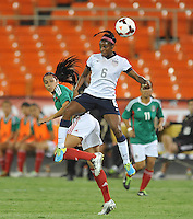 Crystal Dunn (8) of the USWNT heads the ball against Renae Cuellar (10) of Mexico.  The USWNT defeated Mexico 7-0 during an international friendly, at RFK Stadium, Tuesday September 3 , 2013.