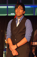 Feb. 27, 2013 - Garden City, New York, U.S. - LUIS TOLOSA, 18, a graduate of the Westbury STEM Magnet Academy (Science, Technology, Engineering, and Math) of the Cradle of Aviation, spoke at the 10th Annual Cradle of Aviation Museum Air & Space Gala, celebrating the 40th Anniversary of Apollo 17. Behind Tolosa is LINDA ARMYN, Chair of the Board of Trustees of the museum.