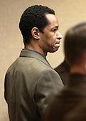Sniper suspect John Allen Muhammad stands as Prince William County (Virginia) Circuit Court Judge LeRoy Millette, Jr., arrives in in courtroom 10 at the Virginia Beach Circuit Court in Virginia Beach, Virginia on November 14, 2003. <br /> Credit: Davis Turner - Pool via CNP