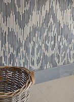 Weft, a jewel glass mosaic shown in glass Quartz and Pearl, is part of the Ikat Collection by New Ravenna Mosaics.