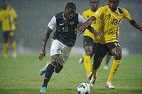 Antigua and Barbuda, Friday, Oct 12, 2012: The USA Men's National Team 2-1 over Antigua and Barbuda in the first round of qualifying for the 2014 World Cup. Eddie Johnson battles for the ball with Thomas Tamorley-Kaharie