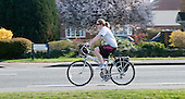 Leisure cyclist, Thames Ditton, Surrey.