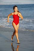 Attractive hispanic woman on beach