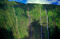 Aerial of waterfalls streaming down mountains on the Kohala coast of the Big Island of Hawaii