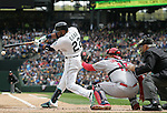 Seattle Mariners'  Robinson Cano hits a grounder against the Los Angeles Angels in the season home opener April 6, 2015 at Safeco Field in Seattle.  The Mariners beat the Angels 4-1.    ©2015. Jim Bryant Photo. ALL RIGHTS RESERVED.