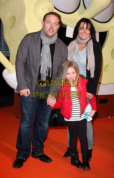 """JOHN THOMSON, wife SAMANTHA SHARPE & daughter OLIVIA.At the """"Spongebob Squarepants - The Sponge who could Fly"""" Gala performance at the Hammersmith Apollo, London, England, .March 5th 2009.musical full length family husband grey gray jacket scarf red jeans child black and white print leggings boots .CAP/ROS.©Steve Ross/Capital Pictures"""