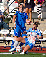 Chicago Red Stars defender/midfielder Lauren Alkek (6) slides to intercept the ball from Boston Breakers forward Katie Schoepfer (2).  The Boston Breakers beat the Chicago Red Stars 1-0 at Dilboy Stadium.