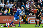 Hearts v St Johnstone...14.08.10  .Ref Stevie O'Reilly throws his red card away as he sends off Steven Anderson after his reckless tackle on Suso Santana.Picture by Graeme Hart..Copyright Perthshire Picture Agency.Tel: 01738 623350  Mobile: 07990 594431