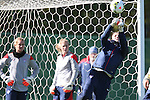 14 October 2014: Hope Solo (right) knocks the ball clear as backups Ashlyn Harris (left) and Alyssa Naeher (center) watch. The United States Women's National Team held a training session on the stadium field at Swope Park Soccer Village in Kansas City, Missouri in preparation for the CONCACAF Women's World Cup Qualifying Tournament for the 2015 Women's World Cup in Canada.