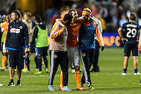 Brian Ownby (22) of the Houston Dynamo is heaped off the field after the match. The Houston Dynamo defeated the Philadelphia Union 1-0 during a Major League Soccer (MLS) match at PPL Park in Chester, PA, on September 14, 2013.