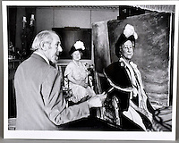 BNPS.co.uk (01202 558833)<br /> Pic: SAS/BNPS<br /> <br /> Bernard painting the Queen Mother in the 1970's.<br /> <br /> An amazing 30 year old time capsule of Royal artworks have been found gathering dust in a dilapidated estate near Tonbridge in Kent.<br /> <br /> They form part of a remarkable collection of 400 works by the almost forgotten painter Bernard Hailstone, that have been locked away in his abandoned studio at Hadlow Tower since his death in 1987.<br /> <br /> Amongst the famous figures who sat for Mr Hailstone, who died in 1987, were the Queen, the Queen Mother, Prince Charles, Winston Churchill, former US president Jimmy Carter and actor Laurence Olivier.<br /> <br /> While sitting for her portrait at Buckingham Palace, The Queen asked him to adjust the aerial so she could watch the horse racing on the TV.<br /> <br /> The then US president Jimmy Carter was sketched by Mr Hailstone during a flight from London to New York, while Mr Hailstone and Winston Churchill discussed aliens during their sitting at Chartwell.