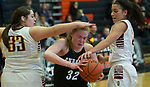 Chugiak's Ashlynn Burgess finds herself sandwiched by Dimond's Hayley Brink and Seanne Bialo during the CIC championship loss to the Lynx.  Photo for the Star by Michael Dinneen