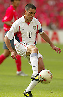 Claudio Reyna collects the ball. The USA tied South Korea, 1-1, during the FIFA World Cup 2002 in Daegu, Korea.