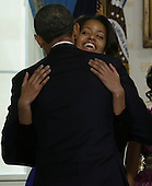 United States President Barack Obama is hugged by this daughter Malia after being officially sworn-in in the Blue Room of the White House during the 57th Presidential Inauguration in Washington, Sunday Jan 20, 2013..Credit: Charles Dharapak / Pool via CNP
