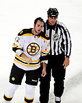24 September 2009: Boston Bruins' left wing forward Guillaume Lefebvre is escorted to the penalty box after a bloody fight against Montreal Canadiens' left wing forward Gregory Stewart in the first period at the Bell Centre in Montreal, Quebec, Canada. The Bruins edged out the Canadiens in an overtime shootout 2-1 in their pre-season matchup. Mandatory Credit: Ed Wolfstein Photo