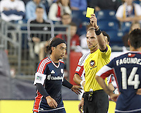 Yellow Card: New England Revolution midfielder Lee Nguyen (24) by referee Ted Unkel. In a Major League Soccer (MLS) match, the New England Revolution (blue) tied D.C. United (white), 0-0, at Gillette Stadium on June 8, 2013.