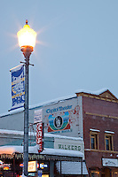 """Downtown Truckee 5"" - Photograph of a California Welcome Center sign with Commercial Row in Downtown Truckee in the background."
