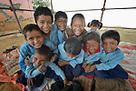 Children pose as they wait for their class to start in Pida, a village in Nepal's Dhading District where the United Methodist Committee on Relief (UMCOR), a member of the ACT Alliance, is helping families to rebuild their lives in the wake of the 2015 earthquake that ravaged much of Nepal. Their classroom was built by UMCOR after the existing school building was severely damaged by the quake.