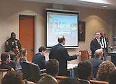 Defense attorney Pete Greenspun, standing center, makes an objection as Prosecutor Richard Conway, standing right, and sniper suspect John Allen Muhammad, seated left, listen during his trial in courtroom 10 at the Virginia Beach Circuit Court in Virginia Beach, Virginia on October 30, 2003.   A photo of the shooting scene where Linda Franklin was shot is projected on the screen. <br /> Credit: Adrin Snider - Pool via CNP