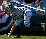 06/19/2006 Cal State Fullerton's Evan McArthur picks up Brad Chalk  bunt during game nine of the College World Series in Omaha Nebraska Tuesday afternoon..(photo by Chris Machian/Prairie Pixel Group)