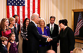 United States Vice President Joe Biden (L) shakes hands with U.S. Supreme Court Justice Sonia Sotomayor after taking the oath of office at the U.S. Naval Observatory in Washington January 20, 2013.   .Credit: Kevin Lamarque / Pool via CNP