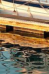 Reflections of a boat in Pillar Point Harbor, Half Moon Bay, California