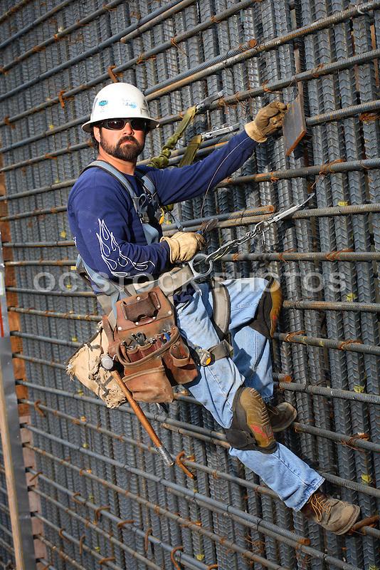 construction worker hanging on rebar rebar worker